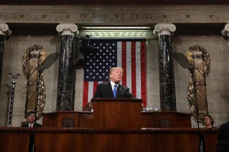 Trump greets the union with an open hand and a clenched fist