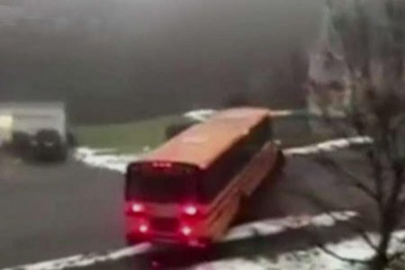 School bus full of children slides down icy road in Massachusetts, hits parked car