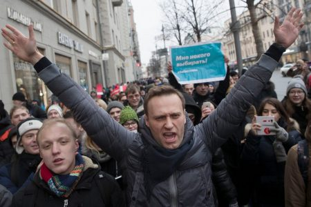 Russian protesters urge boycott of presidential vote even as opposition leader Navalny is arrested