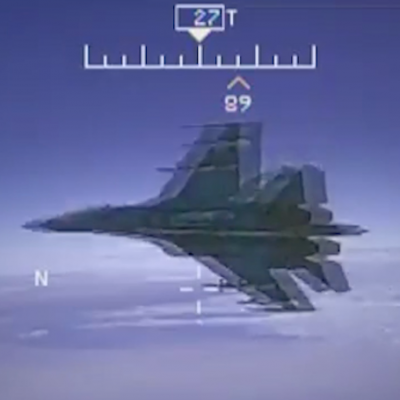 Insane video shows a Russian military jet flying within 5 feet of a US Navy plane