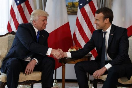 Trump and Macron: From white-knuckle handshake to red-carpet embrace