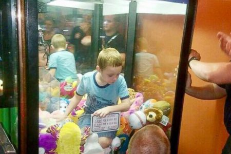 Fire department frees young boy who crawled into a claw machine to get a toy