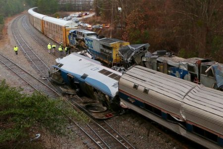 Amtrak train on wrong track in deadly crash; it says freight line controls signals