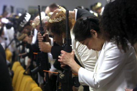 With crowns on their heads and AR-15s in their arms, couples exchange vows in pro-gun church