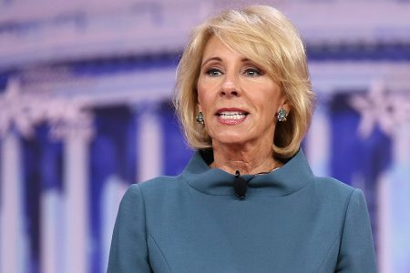 DeVos pressed on performance of public schools under policies she promoted