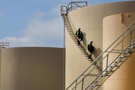 US crude takes aim at $70 a barrel as oil stockpiles fall, gasoline demand hits record