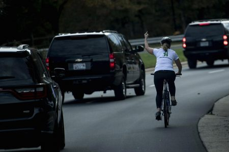 Cyclist fired for flipping off the President's motorcade is suing her former employer