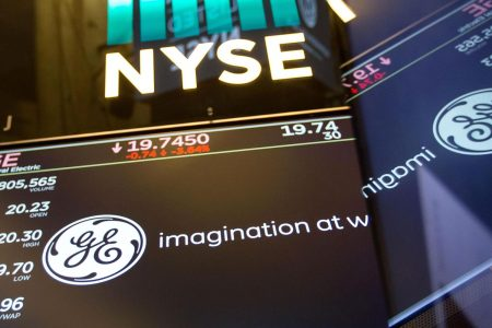 General Electric shares jump as earnings top estimates, backs 2018 outlook