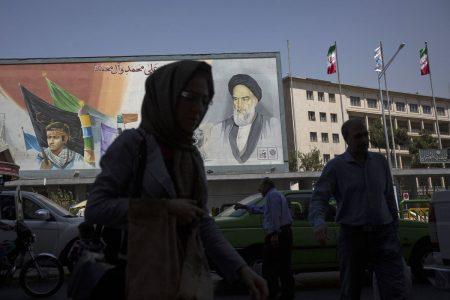 Macron, Merkel Prepare Hard Sell for Trump on Iran Accord