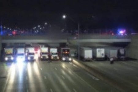 A man nearly jumped off an overpass. 13 truckers made a safety net.