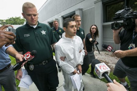 A Florida school shooting suspect charged with terrorism says 'sorry' to injured student