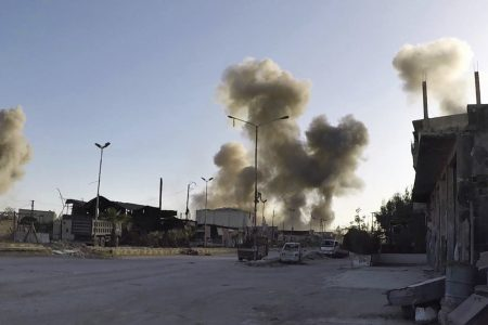 Dozens killed in apparent chemical weapons attack on civilians in Syria, rescue workers say
