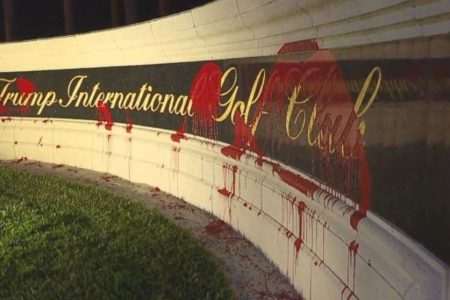 Trump International Golf Club sign splattered with red paint by vandals