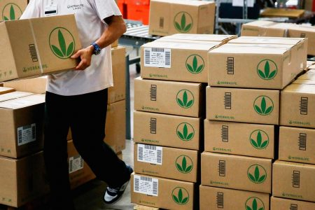Herbalife shares plunge after Carl Icahn said he is lowering his stake in the company