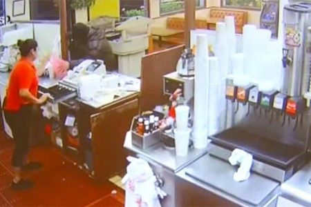 Armed customer thwarts restaurant robbery