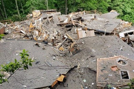 North Carolina floods trigger house collapse; two people missing
