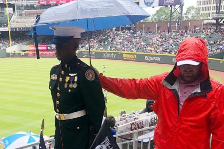 As JROTC member offers respect to POW-MIAs, a baseball fan does his part, too
