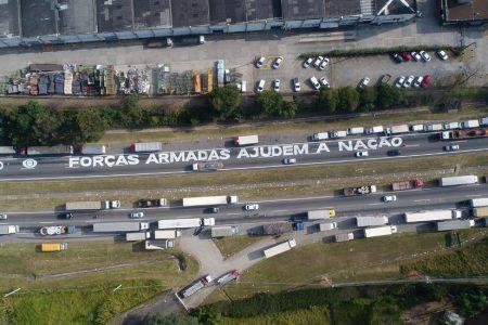 Truckers' Strike Paralyzes Brazil as President Courts Investors