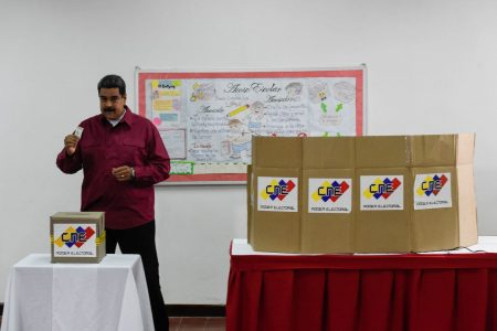 Crisis-weary Venezuelans are voting in election decried as a Maduro power grab