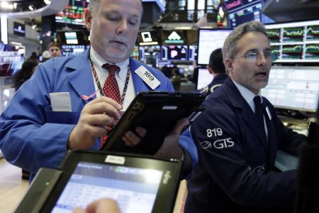 """Dow jumps nearly 300 points as US says trade war with China """"on hold"""""""