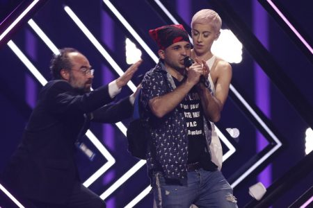 The Latest: Protester climbs on stage at Eurovision contest