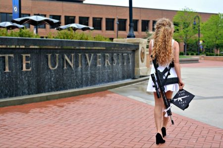 The story behind the viral photo of a Kent State graduate posing with her cap — and a rifle