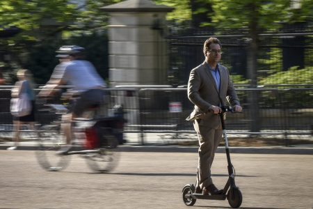 The invasion of the scooter bros: A new tribe whizzes past the haters on Washington sidewalks.