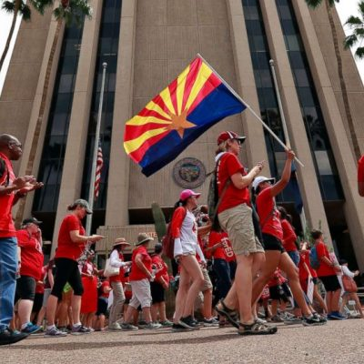 Striking Arizona teachers cover Capitol in red
