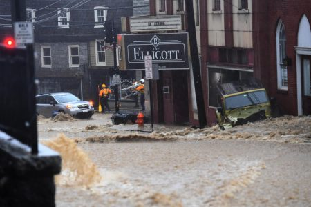 'Washed away real quick': Massive flooding leaves man missing, damages buildings