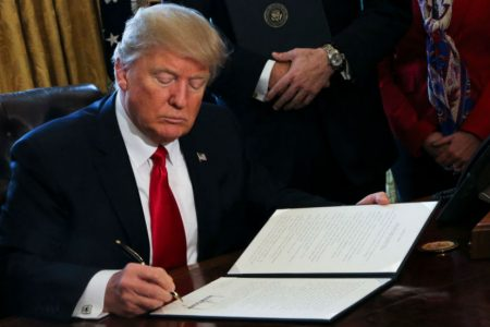 Trump signs repeal of auto-loan policy that targeted racial bias