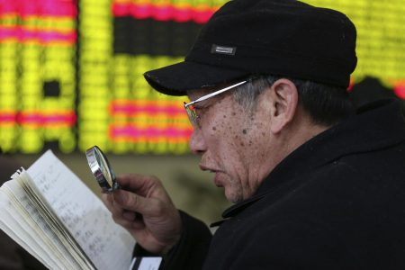 Shares in Asia cautiously mixed as trade concerns return to the fore
