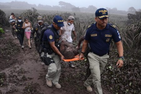 Guatemalans struggle to recover the dead buried by volcano eruption