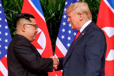 Trump and Kim sign document committing to 'work to complete denuclearization of the Korean peninsula'