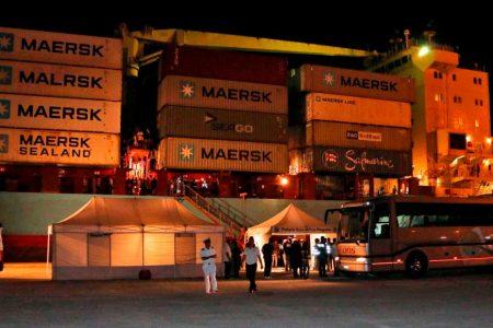 Migrants leave cargo ship in Italy, but NGO vessel still stranded
