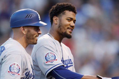Santana picks up win in debut, Dodgers beat Rockies 11-8