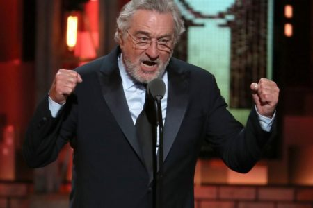 Trump supporter disrupts De Niro's musical with 'Keep America Great' flag