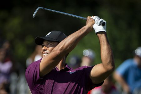 Tiger Woods played like Tiger Woods on Friday, and it's still something to see
