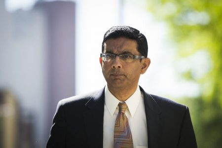 Trump pardons conservative pundit Dinesh D'Souza, suggests others also could receive clemency