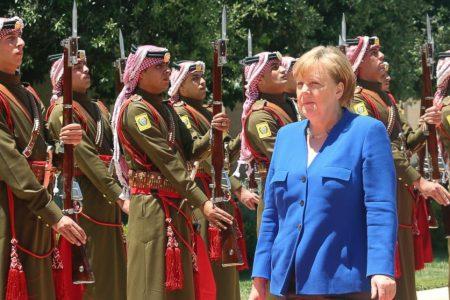 Merkel pledges $100M loan for troubled Jordan
