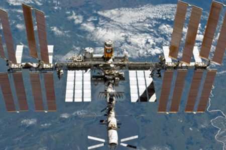 Space station astronauts take spacewalk to install cameras
