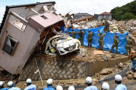 Amid Japan's Flood Devastation, Survivors Dig Out