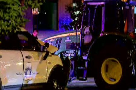Slow-speed pursuit of tractor leads to crash, arrest, 2 cops injured