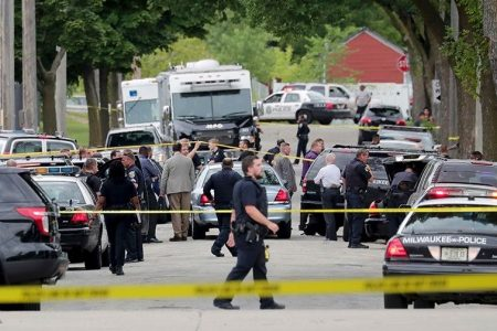 Milwaukee police officer shot and killed, local media reports