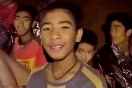Boys, soccer coach trapped in Thai cave exchange notes with families