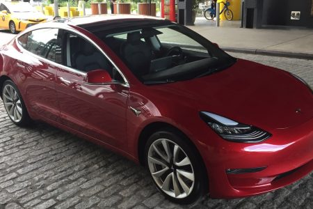Thousands of Tesla Model 3 cars are sitting in giant parking lots in California — here's why