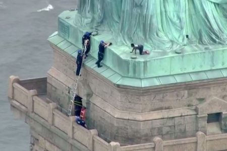 Statue of Liberty protester is immigrant active in resisting Trump policy