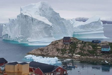 An 11 million-ton iceberg is threatening a tiny village in Greenland