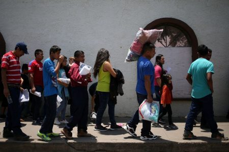 Hundreds of migrant children remain in custody, though most separated families are reunited at court deadline
