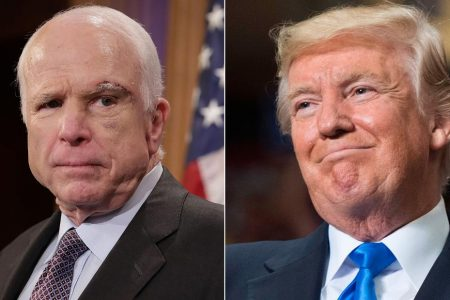 Trump signs McCain defense measure, doesn't thank McCain