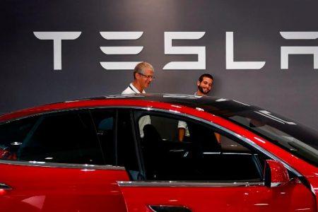 Apple profit soars; Tariff threats; Tesla earnings